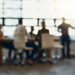 Full length bokeh shot of a group of corporate businesspeople meeting in the boardroom